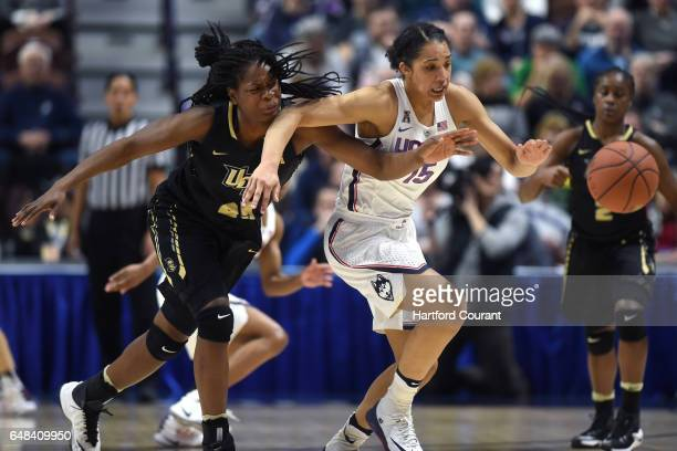 Connecticut Huskies guard Gabby Williams steals the ball from UCF Knights forward Tolulope Omokore in a semifinal game of the AAC Women's Basketball...