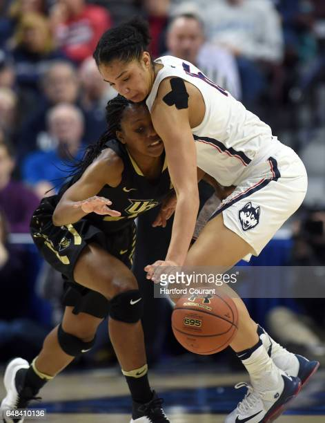 Connecticut Huskies guard Gabby Williams steals the ball from UCF Knights guard Zykira Lewis in a semifinal game of the AAC Women's Basketball...