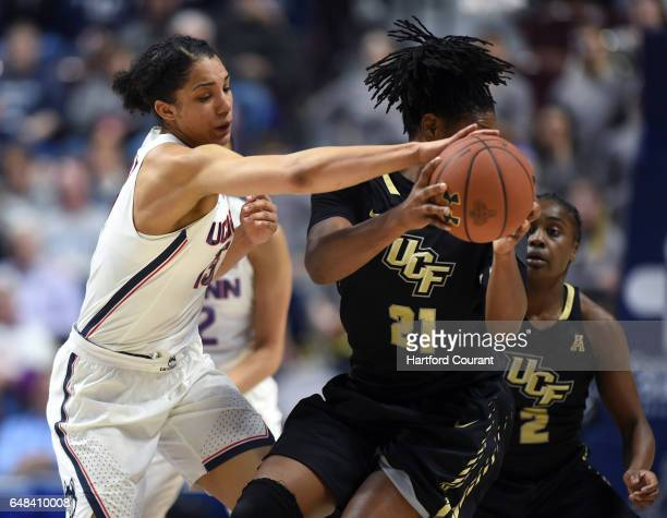 Connecticut Huskies guard Gabby Williams tries to strip the ball from UCF Knights forward Joslyn Massey in a semifinal game of the AAC Women's...