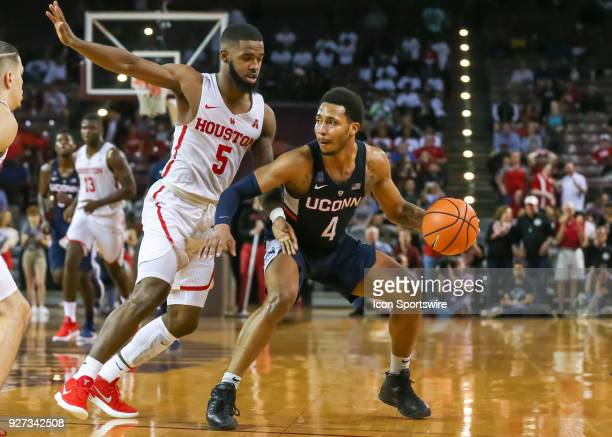 Connecticut Huskies guard Jalen Adams brakes and drives the ball past Houston Cougars guard Corey Davis Jr during the men's basketball game between...
