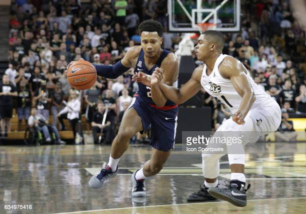 Connecticut Huskies guard Jalen Adams Dribbles the ball UCF Knights During the basketball game between the UCF Nights vs UCONN on February 11th 2017...