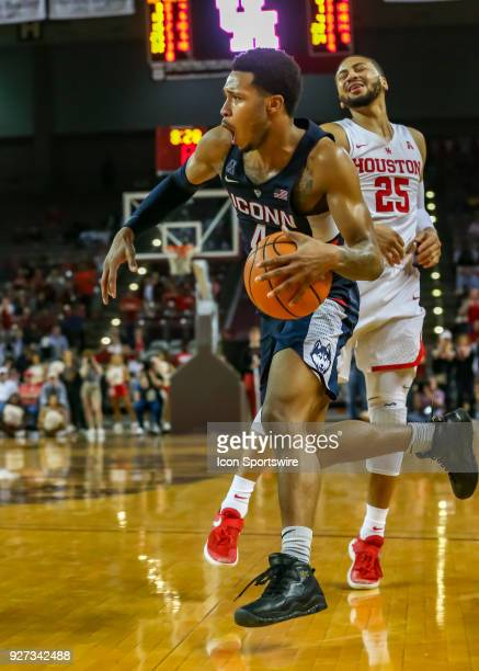 Connecticut Huskies guard Jalen Adams drives the ball pastHouston Cougars guard Galen Robinson Jr during the men's basketball game between the UConn...