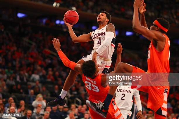 Connecticut Huskies guard Jalen Adams drives to the basket during the second half of the College Basketball game between the Syracuse Orange and the...