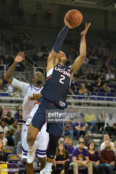 Connecticut Huskies guard Jalen Adams drives to the basket past East Carolina Pirates guard Caleb White in a game between the Connecticut Huskies and...