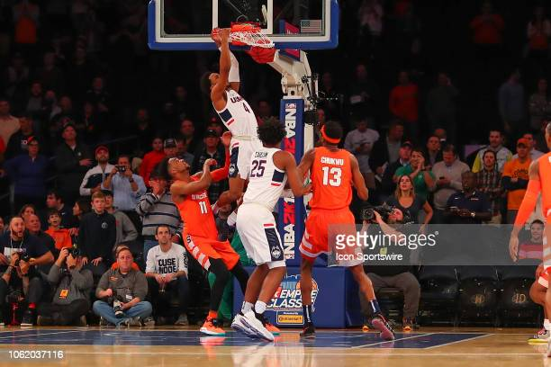 Connecticut Huskies guard Jalen Adams dunks during the first half of the College Basketball game between the Syracuse Orange and the Connecticut...