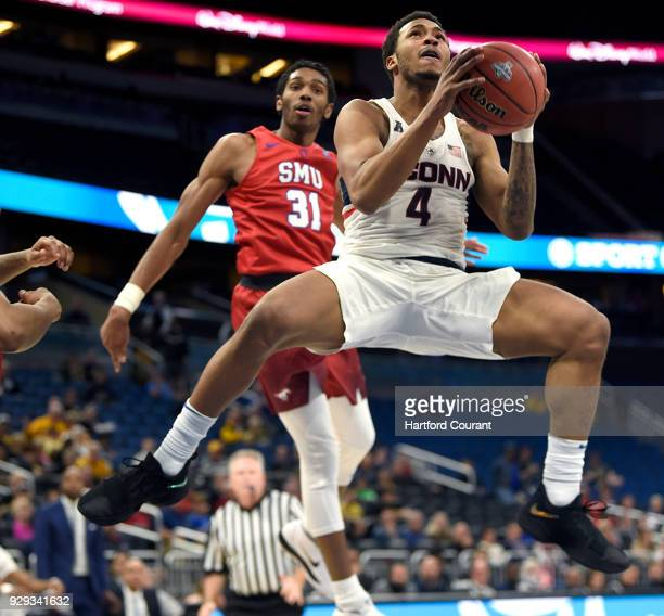 Connecticut Huskies guard Jalen Adams floats to the basket past Southern Methodist Mustangs guard Jimmy Whitt in a first round game at the 2018...