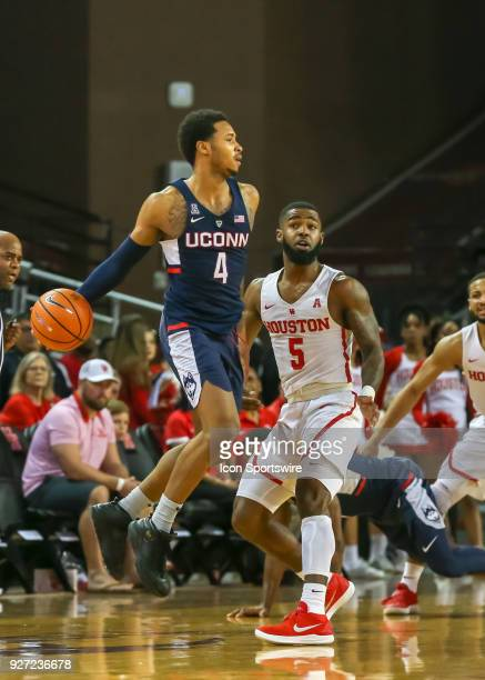 Connecticut Huskies guard Jalen Adams jumps to save the ball from going out fo bounds during the men's basketball game between the UConn Huskies and...