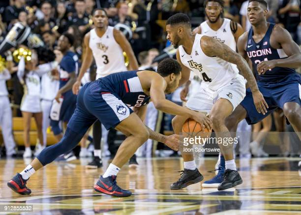 Connecticut Huskies guard Jalen Adams looks to pass during the UCF Knights and the Connecticut Huskies on January 31st 2018 at CFE Arena in Orlando Fl