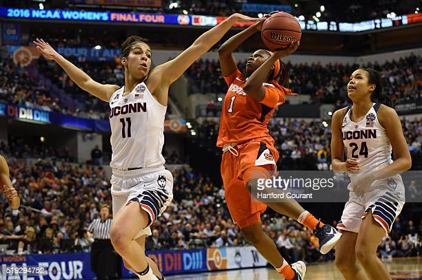 Connecticut Huskies guard Kia Nurse left and Connecticut Huskies guard/forward Napheesa Collier right play defense as Syracuse Orange guard Alexis...