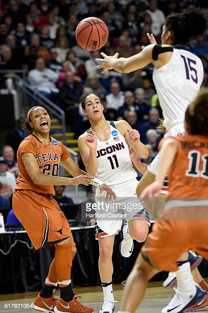 Connecticut Huskies guard Kia Nurse passes to Gabby Williams as she drives to the hoop as Texas Longhorns guard Brianna Taylor defends during the...