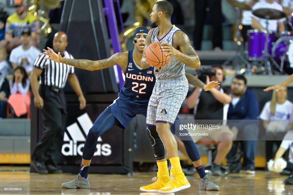 Connecticut Huskies guard Terry Larrier (22) guards East Carolina Pirates guard B.J. Tyson (21) during a game between the ECU Pirates and the UConn Huskies at Williams Arena - Minges Coliseum in Greenville, NC on February 18, 2018.