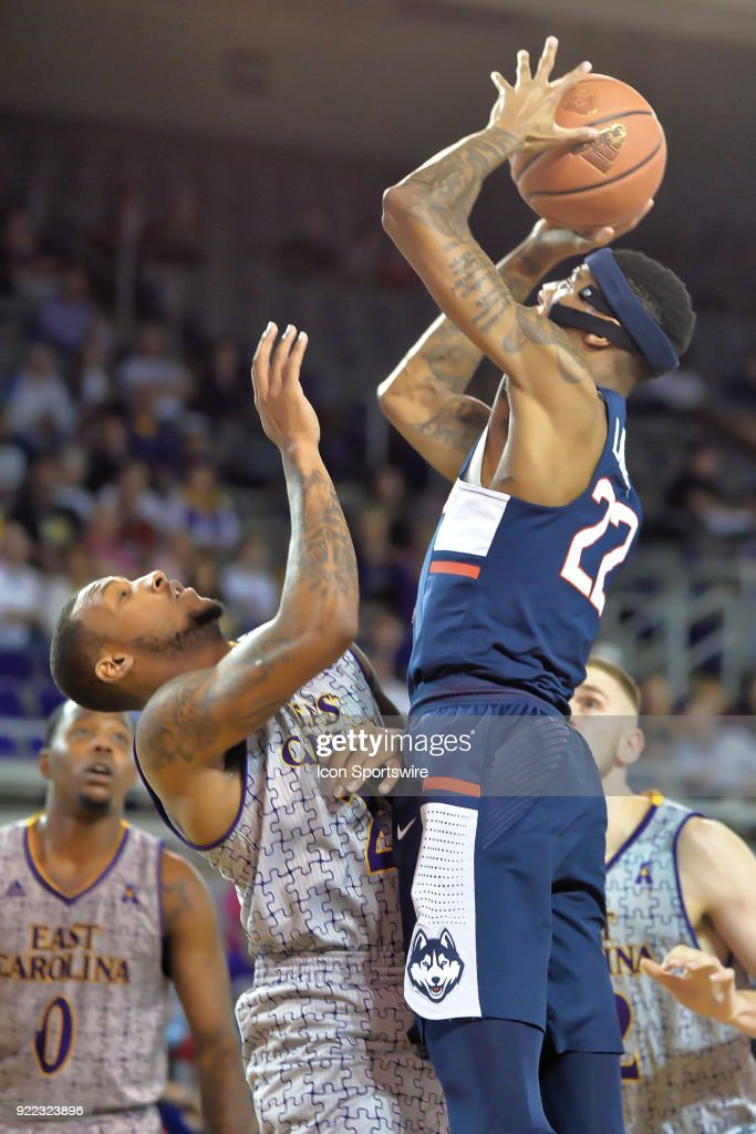 Connecticut Huskies guard Terry Larrier (22) jumps over East Carolina Pirates guard B.J. Tyson (21) during a game between the ECU Pirates and the UConn Huskies at Williams Arena - Minges Coliseum in Greenville, NC on February 18, 2018.