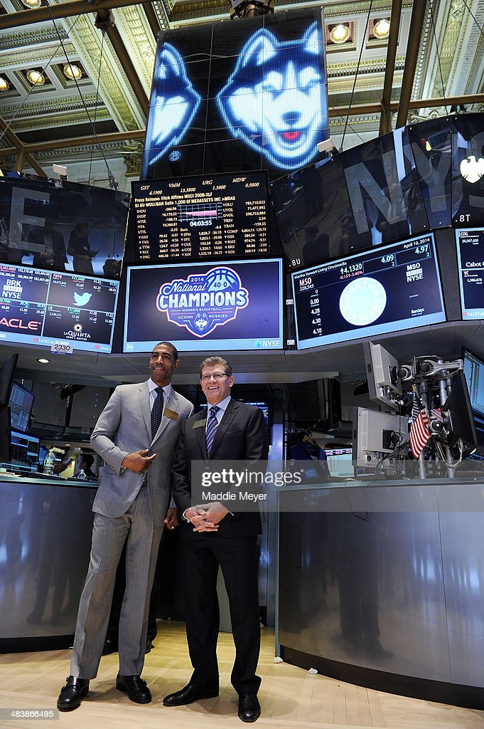 Connecticut Huskies Men's basketball Coach Kevin Ollie (L) and Connecticut Huskies Women's basketball Coach Geno Auriemma stand for a photo on the floor of New York Stock Exchange on April 10, 2014 in New York City.
