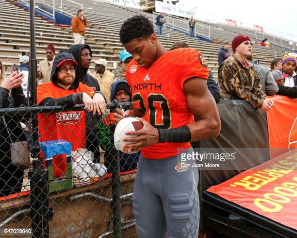 Connecticut Safety Obi Melifonwu of the North Team signs a few items for fans after the 2017 Resse's Senior Bowl at LaddPeebles Stadium on January 28...