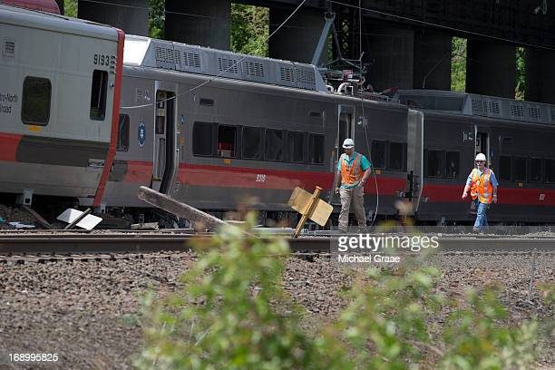 Connecticut state investigators examines the scene of a Metro North train collision on May 18 2013 in Fairfield Connecticut Two New Haven Line Metro...