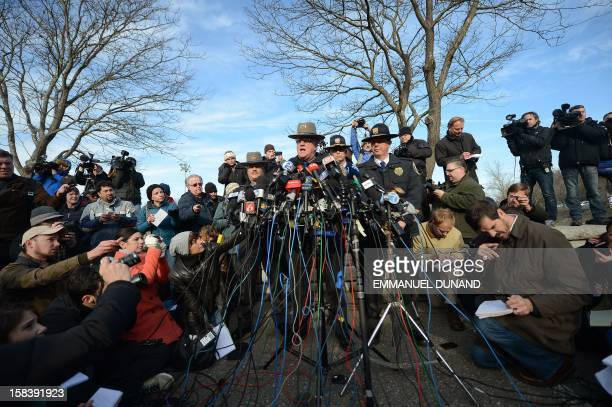 Connecticut State Police Lieutenant Paul Vance addresses a press conference on the situation following an elementary school shooting in Newtown,...