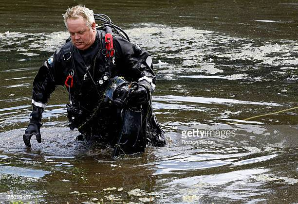Connecticut State Police officer takes a break searching Pine Lake for a gun that police believe was used to kill Odin Lloyd, in Bristol, Conn., July...