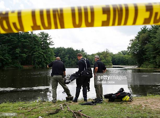 Connecticut State Police officers prepare to search Pine Lake looking for a gun that police believe was used to kill Odin Lloyd, in Bristol, Conn.,...