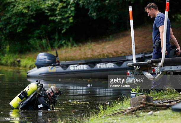Connecticut State Police officers search Pine Lake looking for a gun that police believe was used to kill Odin Lloyd, in Bristol, Conn., July 29,...