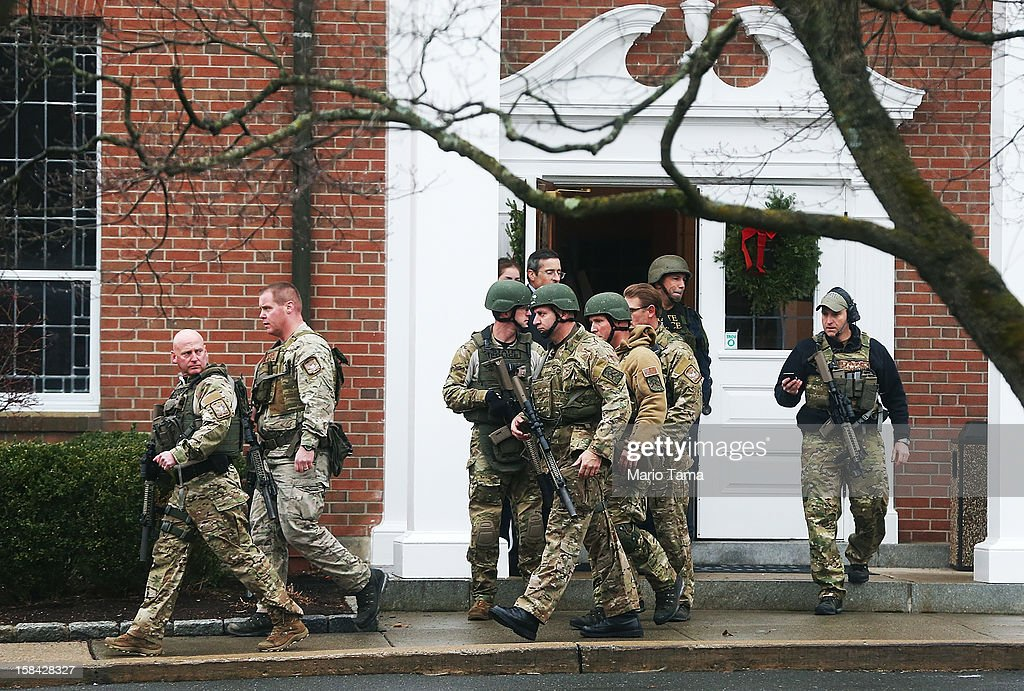 Connecticut State Police officers walk out of St. Rose of Lima Roman Catholic Church after a threat to the church was received during the first day of Sunday services following the mass shooting at Sandy Hook Elementary School on December 16, 2012 in Newtown, Connecticut. The church was evacuated during noon mass due to the unspecified threat and will remain closed the rest of the day. Police have reportedly now given the 'all clear' for the area. On Friday, December 14, twenty six people were shot dead, including twenty children, after a gunman identified as Adam Lanza opened fire in the school. Lanza also reportedly had committed suicide at the scene.