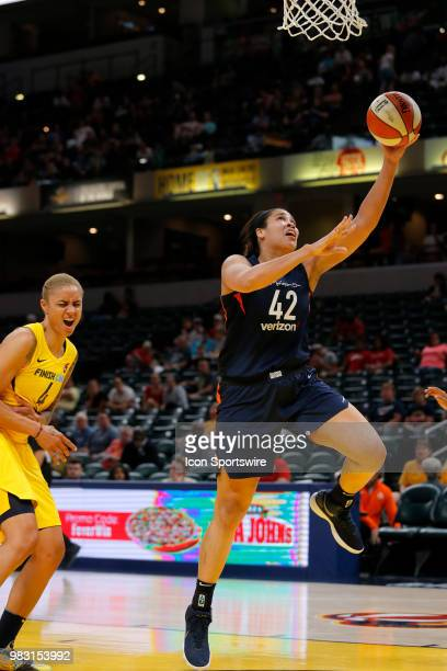 Connecticut Sun center Brionna Jones goes in for the layup past Indiana Fever forward Candice Dupree during the game between the Connecticut Sun and...