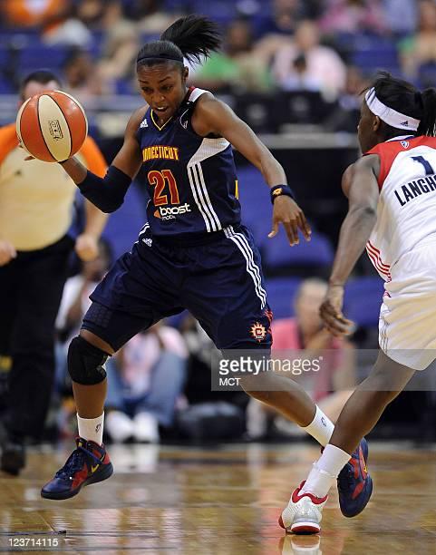 Connecticut Sun center Renee Montgomery breaks up court around Washington Mystics forward Crystal Langhorne during the second quarter at the Verizon...