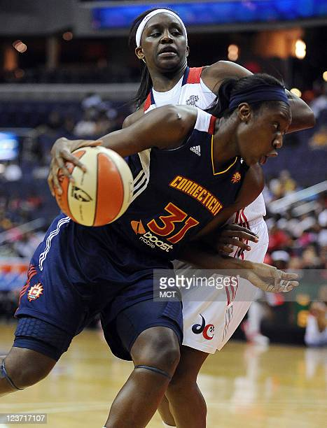 Connecticut Sun center Tina Charles makes a move to the hoop around Washington Mystics forward Crystal Langhorne back during the second quarter at...