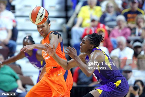 Connecticut Sun forward Alyssa Thomas and Los Angeles Sparks forward Nneka Ogwumike in action during the first half of a WNBA game between Los...