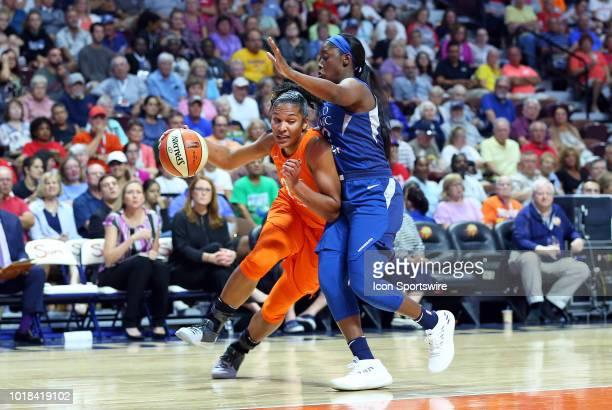 Connecticut Sun forward Alyssa Thomas defended by Minnesota Lynx guard Alexis Jones during a WNBA game between Minnesota Lynx and Connecticut Sun on...
