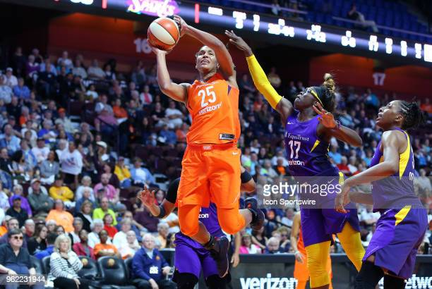 Connecticut Sun forward Alyssa Thomas drives past Los Angeles Sparks forward Essence Carson during a WNBA game between Los Angeles Sparks and...