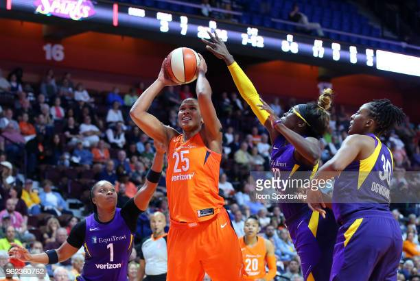 Connecticut Sun forward Alyssa Thomas shoots over Los Angeles Sparks guard Odyssey Sims and Los Angeles Sparks forward Essence Carson during a WNBA...