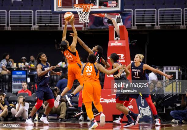 Connecticut Sun forward Betnijah Laney lobs a shot over Washington Mystics guard Ariel Atkins during a WNBA game between the Washington Mystics and...