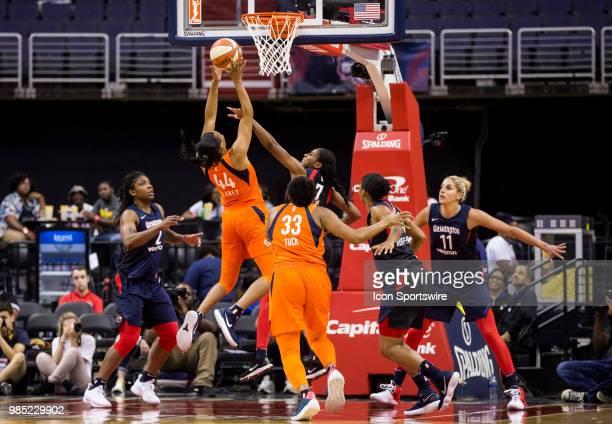 Connecticut Sun forward Betnijah Laney lobs a shot over Washington Mystics guard Ariel Atkins during a WNBA game between the Washington Mystics and...