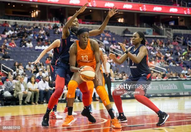 Connecticut Sun forward Chiney Ogwumike caught between Washington Mystics forward LaToya Sanders and guard Ariel Atkins during a WNBA game between...