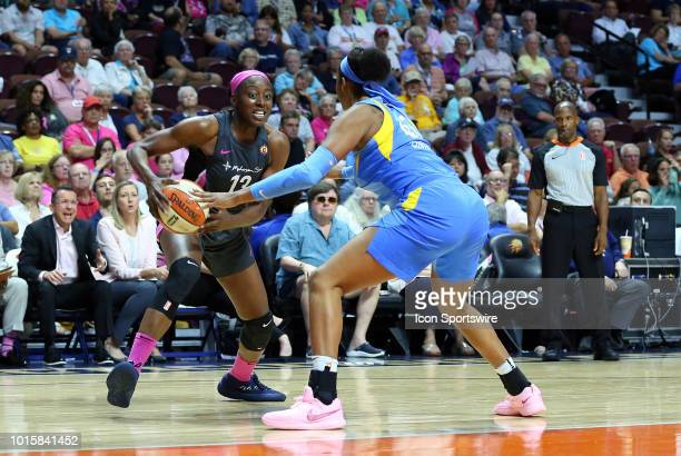 Connecticut Sun forward Chiney Ogwumike drives past Chicago Sky center Alaina Coates during a WNBA game between Chicago Sky and Connecticut Sun on...