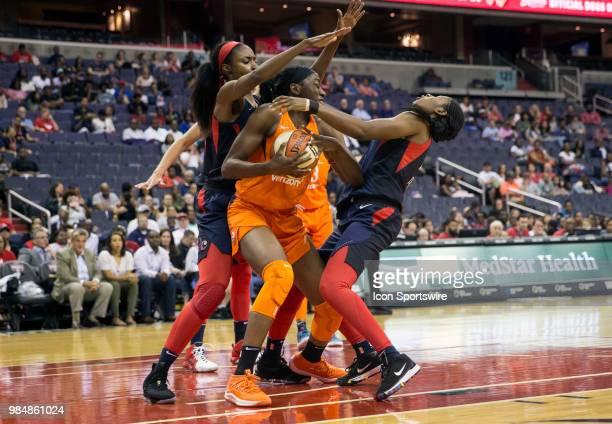 Connecticut Sun forward Chiney Ogwumike knocks over Washington Mystics guard Ariel Atkins during a WNBA game between the Washington Mystics and the...