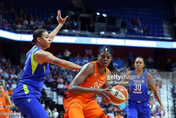 Connecticut Sun forward Jonquel Jones and Dallas Wings center Liz Cambage in action during a WNBA game between Dallas Wings and Connecticut Sun on...
