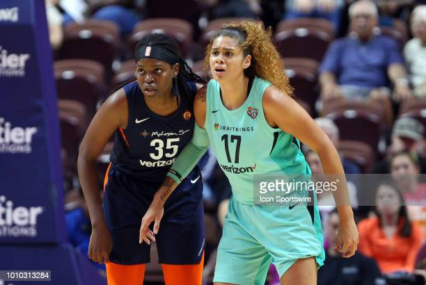 Connecticut Sun forward Jonquel Jones and New York Liberty center Amanda Zahui B in action during a WNBA game between New York Liberty and...