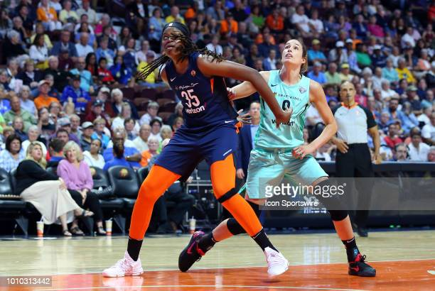 Connecticut Sun forward Jonquel Jones and New York Liberty forward Rebecca Allen battle for position during a WNBA game between New York Liberty and...