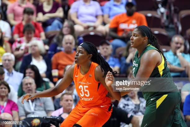 Connecticut Sun forward Jonquel Jones and Seattle Storm center Courtney Paris battle for position during a WNBA game between Seattle Storm and...