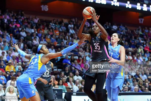 Connecticut Sun forward Jonquel Jones defended by Chicago Sky center Alaina Coates and Chicago Sky center Stefanie Dolson during a WNBA game between...