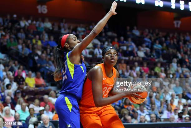 Connecticut Sun forward Jonquel Jones defended by Dallas Wings forward Glory Johnson during a WNBA game between Dallas Wings and Connecticut Sun on...