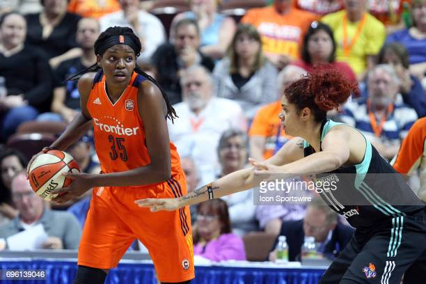 Connecticut Sun forward Jonquel Jones defended by New York Liberty center Amanda Zahui B during the second half of an WNBA game between New York...