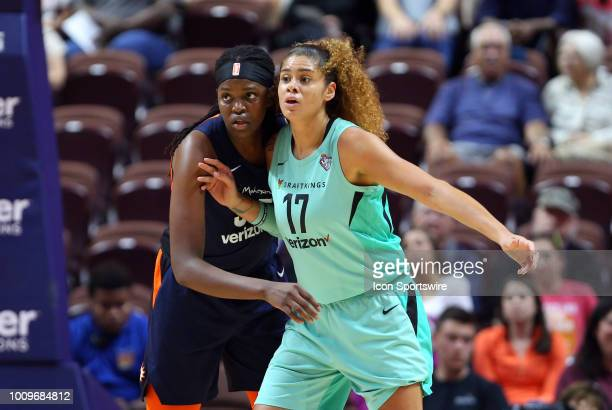Connecticut Sun forward Jonquel Jones defends New York Liberty center Amanda Zahui B during a WNBA game between New York Liberty and Connecticut Sun...