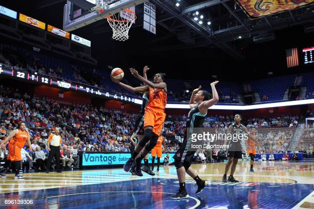 Connecticut Sun forward Jonquel Jones drives to the basket during the first half of an WNBA game between New York Liberty and Connecticut Sun on June...