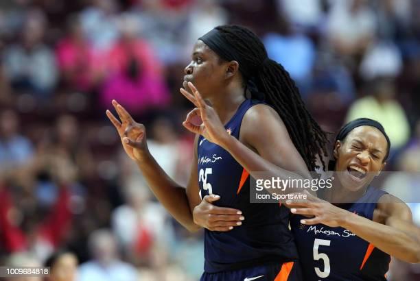 Connecticut Sun forward Jonquel Jones gestures after making a three point shot and Connecticut Sun guard Jasmine Thomas celebrates during a WNBA game...