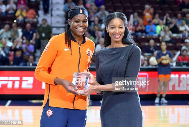 Connecticut Sun forward Jonquel Jones presented with the Sixth Woman of the Year Award prior to the second round of the WNBA playoff game between...