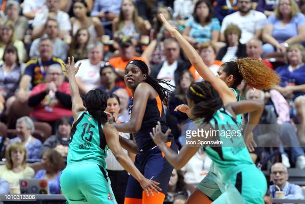 Connecticut Sun forward Jonquel Jones tripledteamed during a WNBA game between New York Liberty and Connecticut Sun on August 1 at Mohegan Sun Arena...