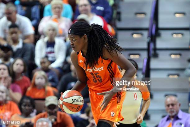 Connecticut Sun forward Jonquel Jones with the ball during the first half of an WNBA second round playoff game between Phoenix Mercury and...