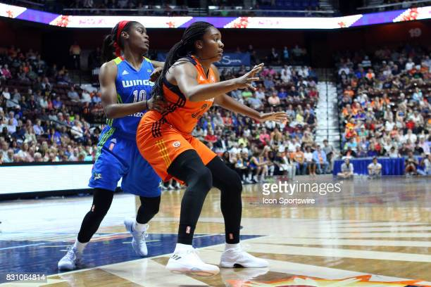 Connecticut Sun forward Morgan Tuck and Dallas Wings guard Kaela Davis in action during the first half of an WNBA game between Dallas Wings and...